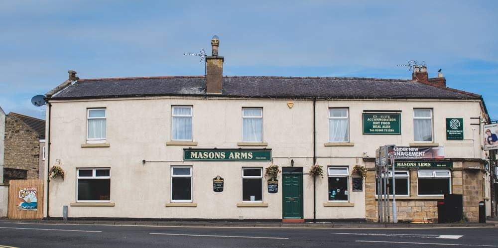 Exterior shot of The Masons Arms in Amble.